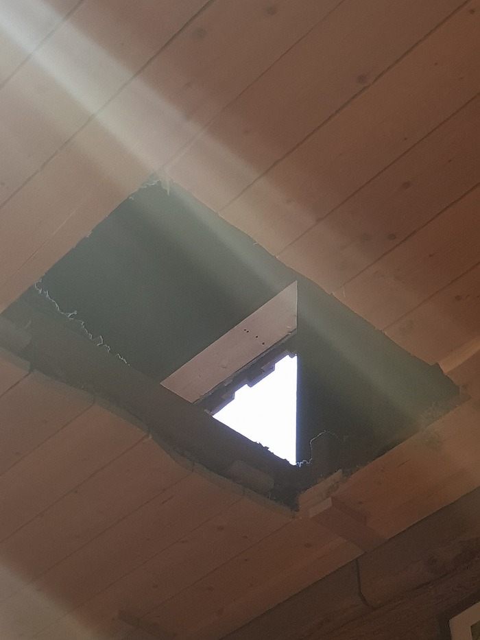 Hole in the ceiling made by burglars